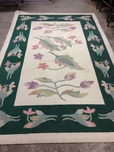 Pair of Floral Wool Rugs. Estate Contents Auction Ending 5/14 Items include children's Thomasville bedroom set, artwork, farm table, rugs, jewelry case, glassware, and much more!