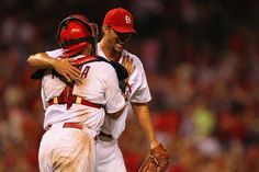 Starting pitcher Adam Wainwright celebrates with Yadier Molina after throwing a complete game to beat the Atlanta Braves...Cards won the game 3-1.   8-23-13