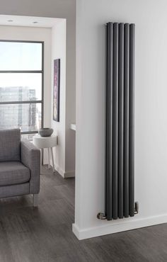 The Radiator Company Ellipsis Double Vertical radiator, This steel radiator has elegant x oval tubes which create powerful lines and pleasing aesthetic and is available in 5 heights and The Ellipsis comes complete with a 10 year guarantee. Tall Radiators, Vertical Radiators, Kitchen Radiators, Contemporary Radiators, Decorative Radiators, Designer Radiator, Front Rooms, Living Room Modern, Houses