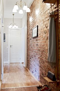 We love the idea of bringing the outdoor elements inside - this brick wall is a great example