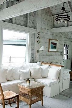 Love the look of this living room- comfy white sectional and distressed light gray plank walls and ceiling.