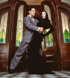 "Anjelica Huston (July 8, 1951 - ) as Morticia Addams and Raul Julia (March 9, 1940 - October 24, 1994)  as Gomez Addams ""The Addams Family"", 1991 #actor"