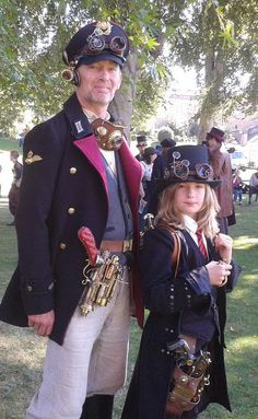 Steampunk father and son (happy father's day!) - For costume tutorials, clothing guide, fashion inspiration photo gallery, calendar of Steampunk events, & more, visit SteampunkFashionGuide.com