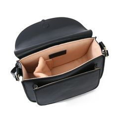 870c9647dd Lola in Noir is the most stylish camera purse that tailors to any style.  The interior is furnished with peach-lined padded sides to provide the  cushion for ...