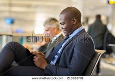 handsome african businessman using tablet computer at airport