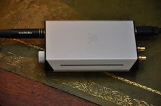 The Acoustic Research UA-1 is a USB powered headphone amplifier and a DAC, supporting hi resolution audio up to 192kHz.  Very simple in design, minimalist in look it is, thus far, a faultless performer on my laptop