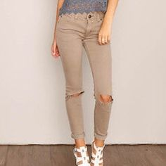 Free People Distressed Skinny Jeans Distressed stretch denim skinnies with blown out knees, classic five-pocket design, and zip fly with button closure. Size 27. NWT.  *53% Cotton  *23% Rayon  *22% Polyester  *2% Spandex  *Machine Wash Cold Free People Jeans Skinny