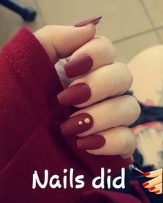 Maroon nails with Matte finish, and gold diamonds.