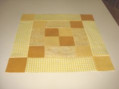 """A traditional block pattern called """"Pennsylvania"""" pieced by Pam Wilson in May 2014, incorporating gingham and other fabrics from the stash of my aunt Johanna Wackerle Tanner.  I varied the pattern by replacing a single center block with a center 4-patch."""