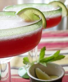 Cranberry Margaritas /   1 (12 ounce) container frozen limeade concentrate (recommended Bacardi brand)  ice cube (1 tray)  8 -12 fluid ounces tequila (8 shots)  4 cups cranberry juice  Directions:      Combine all ingredients in a blender and blend on high. Serve.
