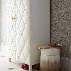 IKEA wardrobe with DIY padded doors and brass hardware