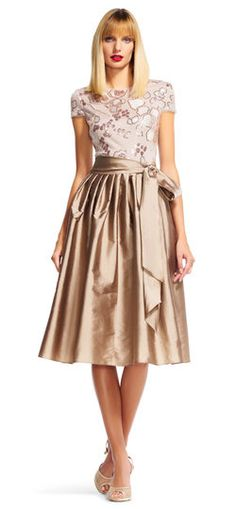 This fit and flare midi dress is a shining addition to your next event. Featuring a full tea length skirt crafted from taffeta and a self-tie sash at the waist, this sophisticated midi dress is a formal must-have. Metallic sequin floral embroidery adorns the short sleeve matte bodice. A deep v-back completes this ladylike design. This short sleeve dress is complete with a neutral heel.