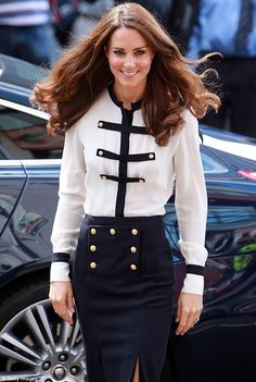 #katemiddleton  wore a navy blue £580 pencil skirt with gold button detailing teamed with a matching £795 cream blouse from the current collection.  Read more: http://www.dailymail.co.uk/femail/article-2027967/The-unofficial-face-McQueen-Duchess-Cambridge-steps-design-Sarah-Burton.html#ixzz1VYN4ksUp