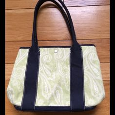 """J.Crew Canvas Tote NWT, cute paisley design green & navy canvas tote. Has snap closure at top with 2 interior open top pockets. Each side also has snaps to either keep closed or open up for more space. All material including lining is 100% cotton. Hand,especially are 9"""" from bag. J. Crew Bags Totes"""