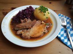 Traditional German Food: Schweinebraten mit Klößen ind Rotkohl | Pork roast served with potato dumplings and red cabbage