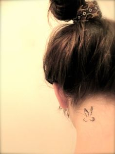 Tiny bird tattoo. Would never get one on my neck, buts its a cute little bird.