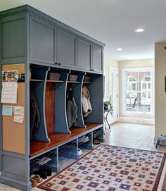 Mud room- accent color, cell phone charging nook, lockers, wood bench to match beams, peg board.