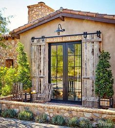 There's no random decorating in this house. Exterior stone and wood detailing is carried throughout the home's exterior and interior alike. Subtle greenery and wooden patio furniture add charm to the home's many outdoor seating areas.