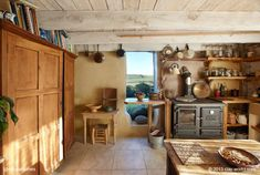 This is Adam and Katy's kitchen in their Cornish cob home [more here www.naturalhomes.org/timeline/clayworks.htm]. The house is a converted 17th century stone, cob, oak and thatch granary that they bought in 2008 and restored it to make it their home.