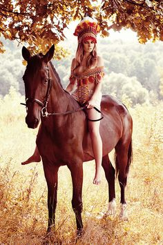 Kinda a wild looking lady on a horse. That's different, lol. #horse