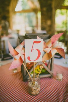 Pinwheel centerpieces | Southern Elegance At This Sunset Inspired North Carolina Graylyn Estate Wedding | Photograph by Carolyn Scott Photography  http://storyboardwedding.com/southern-elegance-north-carolina-graylyn-estate-wedding