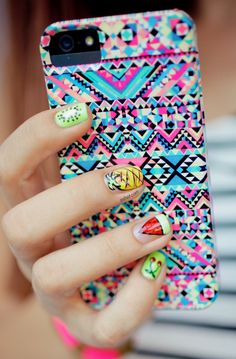 Iphone case and her PINEAPPLE NAIL LOL me pineapples, turtles, red, vamps etc excite me!!!! I really like the intricate pattern of the design on this case. The colors, are very bright and contrast well with each other. I also like how the creator used repetition both with eh different designs and colors.