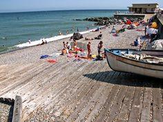 Bathers enjoying the sun on Sherringham beach.