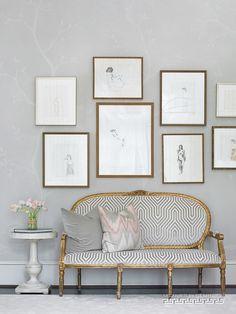 Beautiful art arrangement above settee