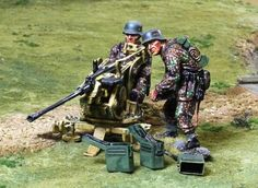World War II German Army CS00808 Waffen SS Flak 41 Team - Made by The Collectors Showcase Military Miniatures and Models. Factory made, hand assembled, painted and boxed in a padded decorative box. Excellent gift for the enthusiast.