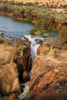 The Kunene River, which constitutes the border between Namibia and Angola, is the confluence of several rivers, which rise in the highlands of Angola, i.e., the Kunene, and later becomes Namibia's fastest-flowing river as it descends rapidly westwards through narrow gorges and steep ravines to the Atlantic Ocean.  Pictured is Epupa Falls.  by Erdem Kutukoglu