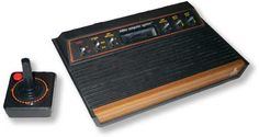 I remember dad having one of these !!  We used to play it all the time haha  Atari 2600 -- Space Invaders, Frogger, etc...