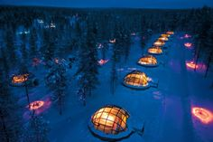 Igloo Village Kakslauttanen in the Arctic Circle in Finland. Accommodations include snow igloos and glass igloos.