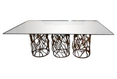 """""""Unique and dramatic hand-forged iron dining table, crafted by an artisan in San Miguel, Mexico."""""""
