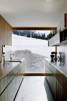 For homeowner Marcell Strolz's chalet in the Austrian resort town of Lech, architect Helmut Dietrich opted for expansive, pressure-resistant panes that would bathe the home with daylight and yet be able to withstand the weight of the area's heavy snowfalls.