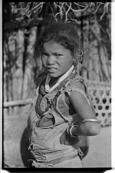 This photograph, taken in Manpur, Dang district, Nepal, shows a young Tharu girl wearing jewellery (1966)