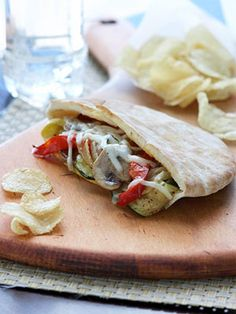 Roasted Veggie Pitas - Roasting brings out the sweetness of the vegetables in this vegetarian sandwich recipe, which is topped off with smoked provolone cheese. Vegetarian Sandwich Recipes, Pita Recipes, Veggie Recipes, Cooking Recipes, Vegetarian Dinners, Wrap Recipes, Waldorf Salat, Diabetic Recipes, Healthy Recipes