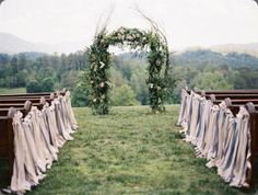 ribbon garland along aisle chairs. 422361_10151130243903970_1151859874_n whimsical gatherings and tec petaja photo