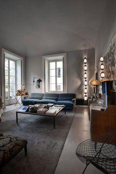 blue sofa, gray walls