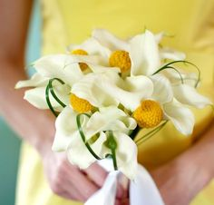 yellow wedding flowers could go in the deeper purple bouquets.