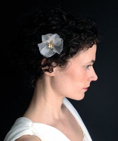 Petite Silk Blossom Comb by Katie Burley Millinery, $60.00 Handmade silk blossom paired with vintage brass flowers and fresh water pearls.