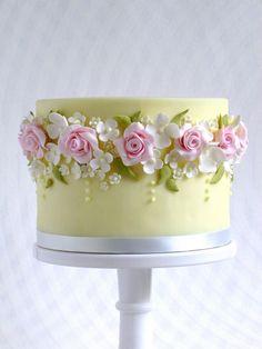 Butter yellow and pink rose wedding cake...www.jevelweddingplanning.com