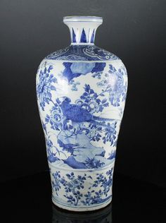 LARGE IMPORTANT ANTIQUE CHINESE MING DYNASTY BLUE AND WHITE MEIPING VASE A large and important vase dating to the late 16th century and finely decorated in underglaze blue. The exterior is hand painted with a continuous landscape scene depicting birds flying. Detail is excellent. The top tapers to a short and flared neck accented with leaves. It stands on a hand cut foot revealing a fine paste. The vase stands an impressive 16.75 inches (42.5 cm) tall and is heavily potted.