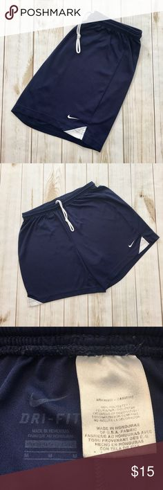 Nike - Men's Dri Fit Liner less Running Shorts Nike - Men's Dri Fit  Navy Blue With White Striped Liner less Running Shorts (size Medium). In exceptional preowned condition. Please be sure to check out all of my other men's items to bundle and save. Same day or next business day shipping is guaranteed. Reasonable offers will be considered. Nike Shorts Athletic