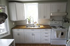 Super inexpensive cabinet makeover (80s style to shaker style), and kitchen makeover via Simple Moments