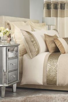 In time for the festive period, opt for a super chic Gold Sequin Panel Bed Set From Next, fit for a queen.