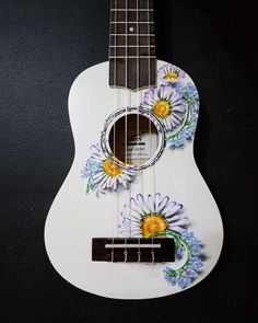 Hand painted custom daisy/forget-me-not ukulele. Ukulele Art, Cool Ukulele, Ukulele Songs, Guitar Art, Acoustic Guitar, Ukelele Painted, Painted Guitars, Ukulele Design, Cool Stuff