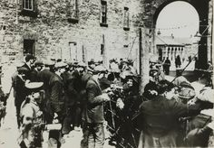 June 1916, Relatives of Republicans visiting the prisoners through the wire at the Richmond Barracks,The Irish rebellion began on Easter Monday 24th April 1916 when the Irish rebels attempted to gain control of public buildings in Dublin.