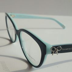 Tiffany & CO Eyeglasses Authentic, new  Tiffany & CO Eyeglasses  Black and teal frame  Size 53-17-140 Includes original case only Tiffany & Co. Accessories Glasses