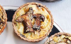 Porchini mushrooms, potatoes, thyme, cream and Parmesan are cooked into little wholeweat tartlets for a delicious, earthy starter