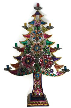 Colorful Mexican Tin Art Christmas Tree Candelabra  This wonderful hand made punched tin Christmas tree has been hand painted with brightly colored flowers.  It has seven c... #vintage #etsy #gifts